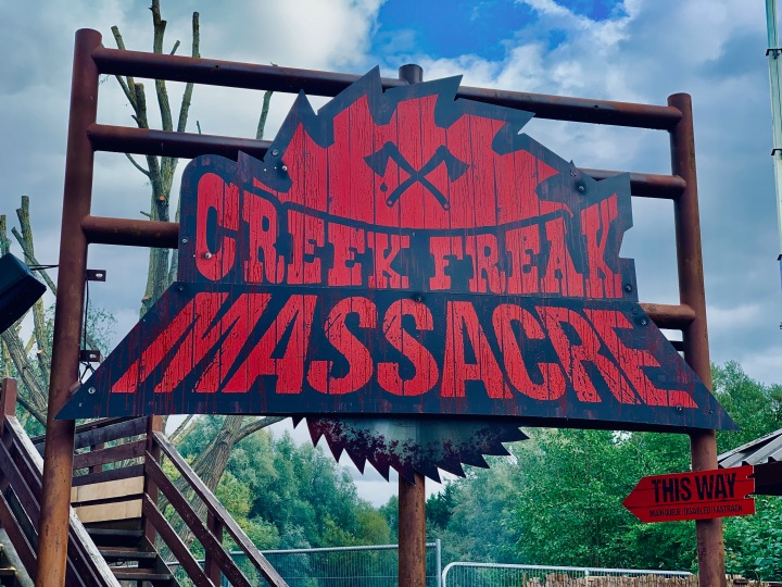 creek freak massacre entrance sign