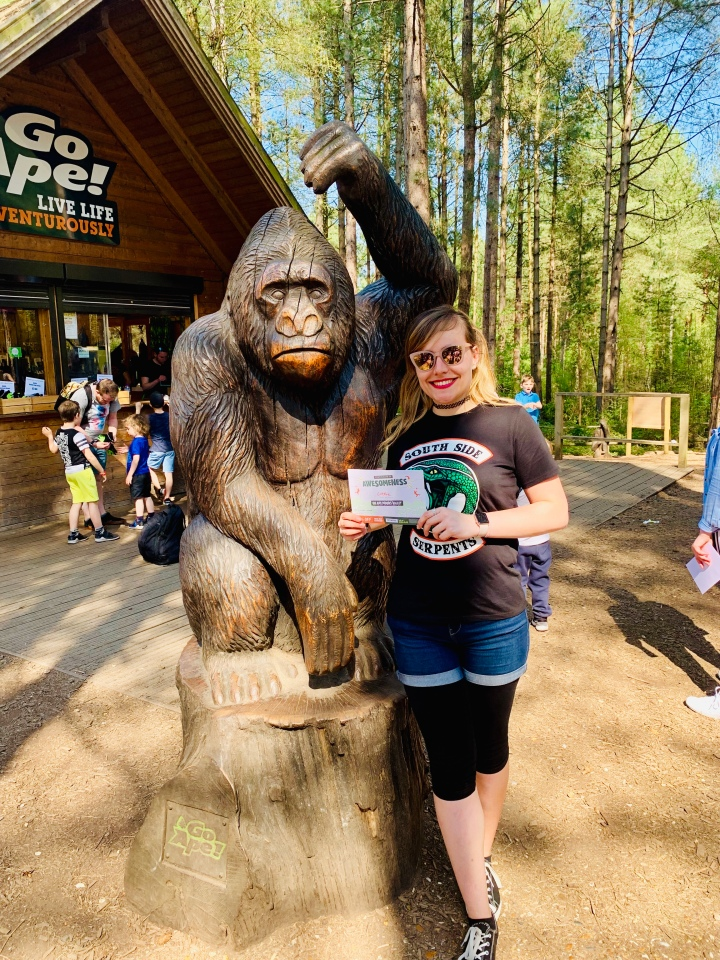 girl stood next to gorilla statue outside go ape moors valley