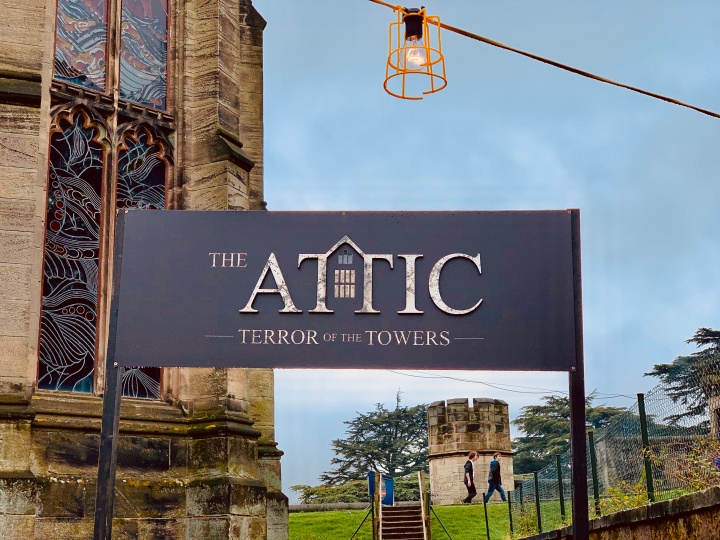 the attic scare maze entrance sign